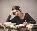 6360484373692429811193259028_81372991SS-Female-student-listening-to-headphones-1